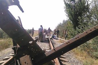 Miners block the railway track in Kryvyi Rih